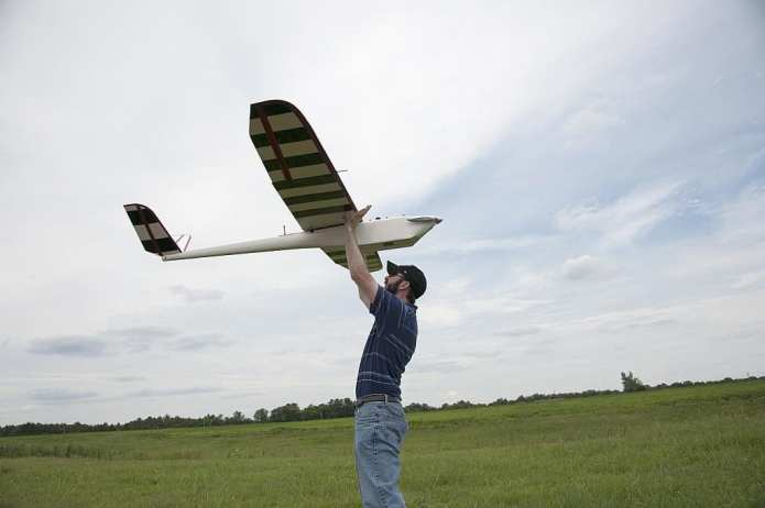 (Photo by MSU Ag Communications/Kat Lawrence) Lee Hathcock, a coordinator with the Mississippi State University Geosystems Research Institute, prepared to launch an unmanned aerial vehicle July 17, 2014 at the MSU Black Belt Experiment Station in Brooksville, Mississippi.