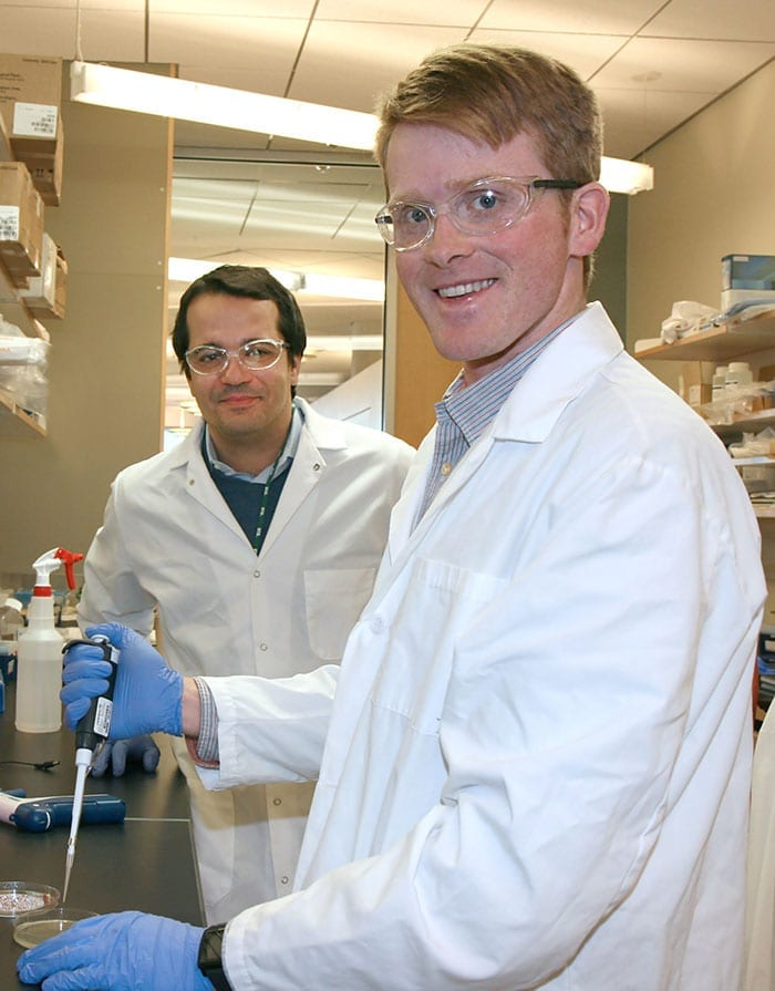 Dr. Leonidas Bleris (left), assistant professor of bioengineering at UT Dallas, and Richard Taplin Moore MS'11 helped create a new delivery system that may change gene therapy.