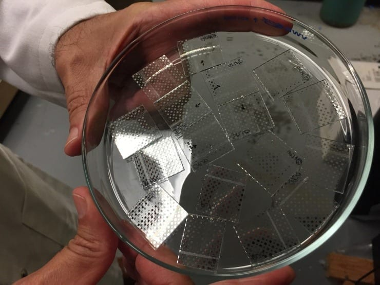 Samples of the new hybrid sol-gel material are shown placed on a clear plastic substrate for testing. (Credit: John Toon, Georgia Tech)