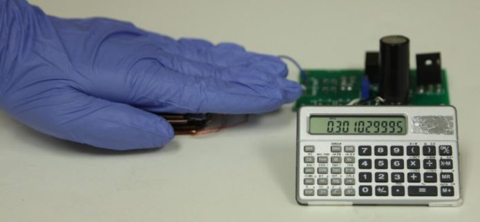 With this triboelectric nanogenerator and two-stage power management and storage system, finger tapping motion generates enough power to operate this scientific calculator. CREDIT Credit: Zhong Lin Wang Laboratory