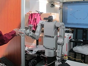 A role adaptation control scheme allows the leader or follower role of a robot to be adjusted continuously based on the sensed intention of a human collaborator. © 2015 A*STAR Institute for Infocomm Research