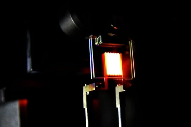 A proof-of-concept device built by MIT researchers demonstrates the principle of a two-stage process to make incandescent bulbs more efficient. This device already achieves efficiency comparable to some compact fluorescent and LED bulbs. Courtesy of the researchers