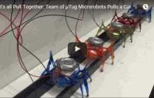 Teams of Tiny Ant-like Robots Can Move a 2-Ton Car