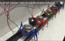 Teams of Tiny Ant-like Robots Can Move a 2-Ton Car