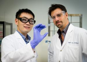 Dr Terry Steele (right) and his student Gao Feng have developed a glue that hardens in response to a small electric current. Credit: Nanyang Technological University