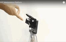 This five-fingered robot hand learns to grasp and grip by doing