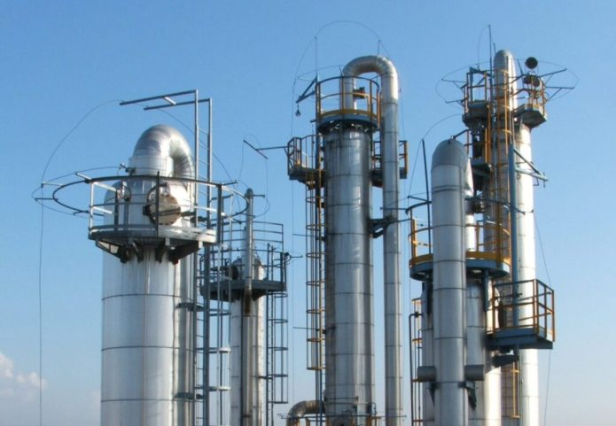 Thermally-based industrial chemical separation processes such as distillation now account for 10 to 15 percent of the world's annual energy use. Shown is an industrial distillation facility in which chemicals are separated according to their boiling points. (Credit: Luigi Chiesa, Wikimedia Commons)