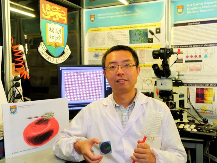Dr Tang Yinyao showing the disc which contains millions of synthetic light-seeking nanorobots
