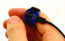 Mobile device controller makes smart wearables easy to control via tiny switch on a ring or bracelet