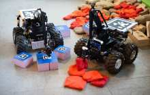 Robot vehicle uses surroundings to build complex structures and overcome obstacles
