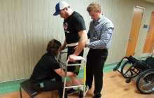 Spinal cord stimulation and physical therapy have helped a man paralyzed since 2013 regain his ability to stand and walk with assistance