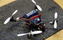 Small flying robots can perch and move objects 40 times their weight