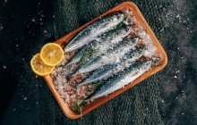 Killing pathogens on seafood with a biodegradable and edible film