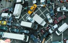 Using connected cars to gridlock entire cities