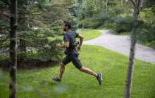 A portable exosuit assists both walking and running