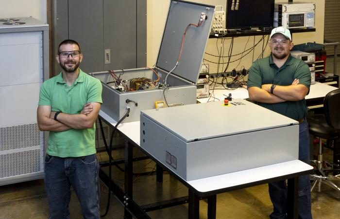 Researchers Steven Campbell (L) and Mitch Smith (R) with the hybrid inverter platform at the ORNL GRID-C development and testing facility. Credit: Carlos Jones, ORNL/U.S. Dept of Energy.