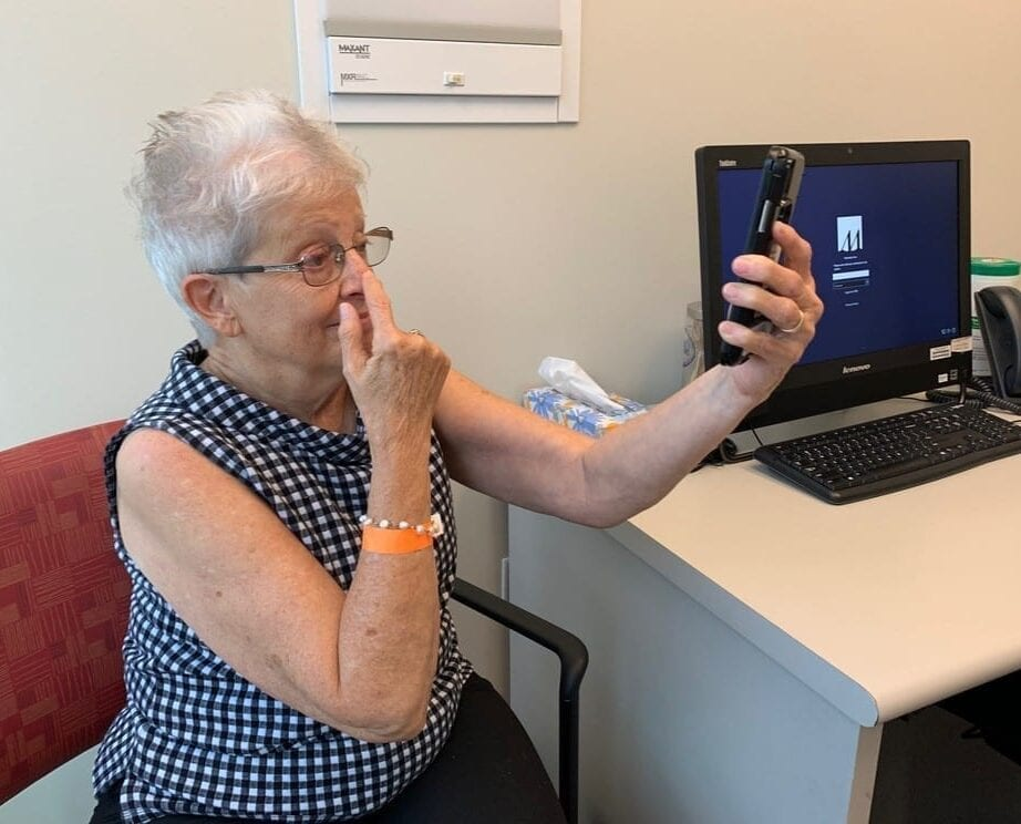 Kathryn Atkinson, a patient at Houston Methodist Hospital, participates in a smartphone screening test to analyze stroke-like symptoms she's experiencing. The test is powered by a machine learning algorithm developed by researchers at Penn State's College of Information Sciences and Technology and Houston Methodist Hospital, which could significantly reduce the amount of time it takes physicians to diagnose a stroke. IMAGE: HOUSTON METHODIST HOSPITAL