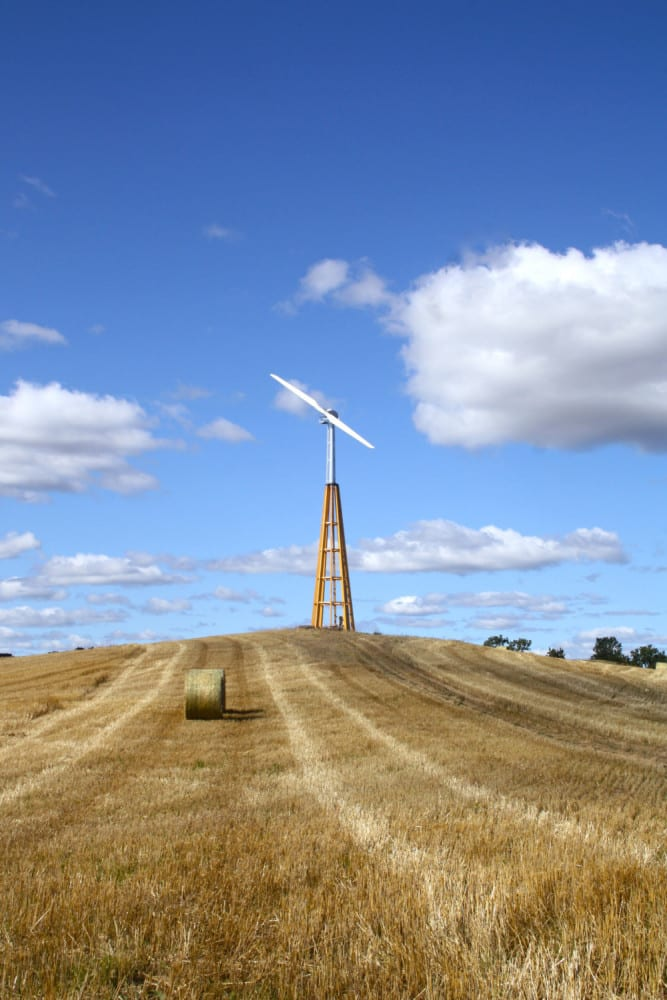 Dalifant small wind turbine on a wooden tower on the farm land