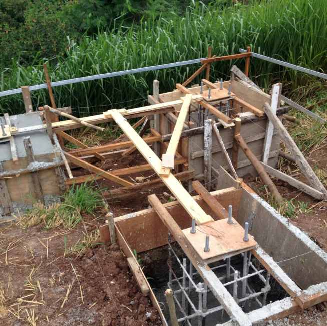 Concrete foundation in process of creation