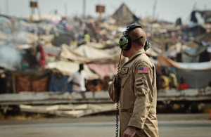 A US soldier surveys a sprawling refugee settlement on the boundary of Bangui International Airport, Central African Republic. Hundreds of thousands of people have been displaced by conflict in the country that the gutting of the US Dodd-Frank Act threatens to exacerbate. Photo courtesy USAFE AFAFRICA/Flickr