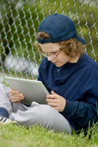 young boy mobile learning with ipad