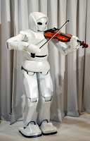 """Toyota Motor Corp.'s violinist robot (""""Life is Movement,"""" Expo 2005, Aichi Japan)"""