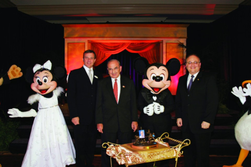 (L to R): Minnie Mouse, Disney CEO Bob Iger, Marty Sklar, Mickey Mouse, and Jay Rassulo (now Disney CFO) celebrate Marty's 50th anniversary with company. Courtesy Marty Sklar.