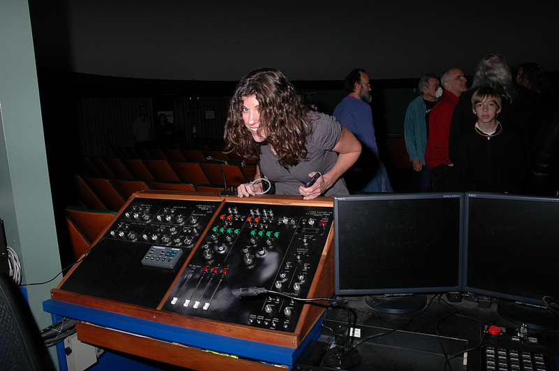 Debbie discovers the planetarium's Laser Fantasy control board.  Photo by Joseph Gutierrez.
