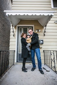Dina Benadon and Brent Young stand on the front porch of the Walt Disney birthplace home, with their young son Truman. Photo © Stephen Green Photography