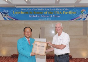 Mayor of Yeosu, Kim Chung–seo receives a plaque from USAP COO Mark Germyn, at an Aug 13 luncheon in honor of the pavilion. Source: www.pavilion2012.org