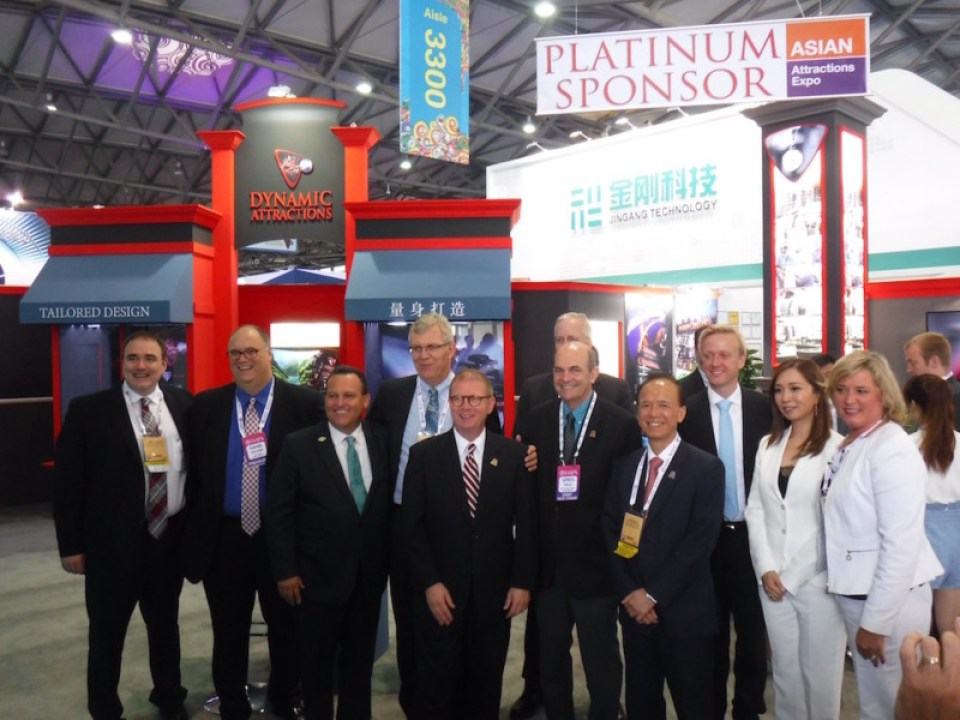 IAAPA leaders visit the booth of Expo Platinum Sponsor Dynamic Attractions