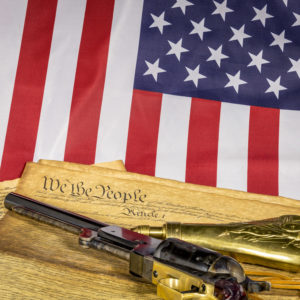 Historic revolver with constitution and American flag