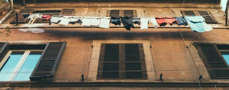 Men hurt other men because man puts clothes on washing line