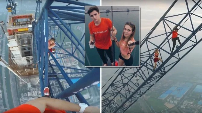 Couple Climbs Worlds Tallest Construction Site Without