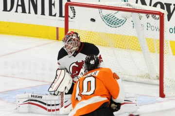Center Vincent Lecavalier (#40) of the Philadelphia Flyers deposits the puck into the back of the net past Goalie Cory Schneider (#35) of the New Jersey Devils