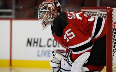 Corey Schneider of the New Jersey Devils looks on intently against the San Jose Sharks on October 18, 2014 at the Prudential Center in Newark, NJ.