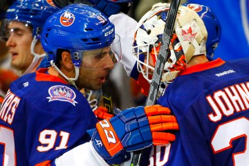 NY Islanders Captain John Tavares congratulates Chad Johnson on the NY Islanders win over the Carolina Hurricanes. (Brandon Titus/Inside Hockey)