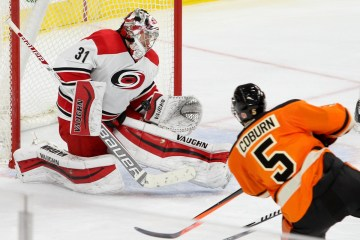 Goalie Anton Khudobin (#31) of the Carolina Hurricanes makes a save on a shot by Defenseman Braydon Coburn (#5) of the Philadelphia Flyers
