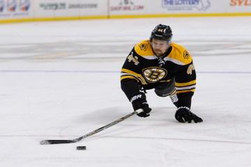 Boston Bruins defenseman Dennis Seidenberg (44) dives for the puck.