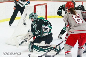Shelby Amsley-Benzie (UND - 1) makes a save against Danielle Gagne (not pictured).