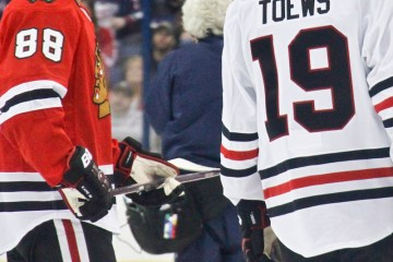 Patrick Kane from the Chicago Blackhawks chats with teammate Jonathan Toews.  Kane won the DraftKings NHL Accuracy Shooting with a time of 13.529 seconds.