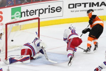 NHL 2015 - Sept 22 - NYR vs PHI - Center Sam Gagner (#89) of the Philadelphia Flyers scores a goal against Goalie Antti Raanta (#32) of the New York Rangers