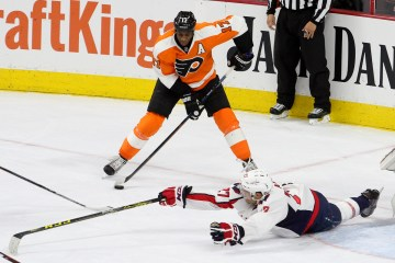 Defenseman Karl Alzner (#27) of the Washington Captials defends against Right Wing Wayne Simmonds (#17) of the Philadelphia Flyers during the first period