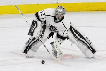 Goalie Jonathan Quick (#32) of the Los Angeles Kings controls the puck during the first period