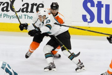Defenseman Nick Schultz (#55) of the Philadelphia Flyers defends against Left Wing Matt Nieto (#83) of the San Jose Sharks during the first period