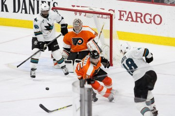 Defenseman Nick Schultz (#55) of the Philadelphia Flyers blocks a shot by Center Tomas Hertl (#48) of the San Jose Sharks during the overtime period