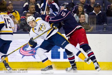 Ryan Johansen (CBJ - 19) tries to knock over Filip Forsberg (NSH - 9).