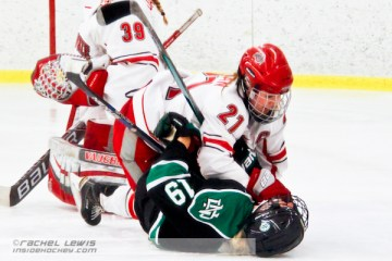 Alexa Ranahan (OSU - 21) smashes Meghan Dufault (UND - 19) into the ice.