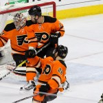 Goalie Steve Mason (#35) of the Philadelphia Flyers makes a glove save against Center Matt Cullen (#7) of the Pittsburgh Penguins during the first period