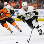 Defenseman Kris Letang (#58) of the Pittsburgh Penguins carries the puck during the second period